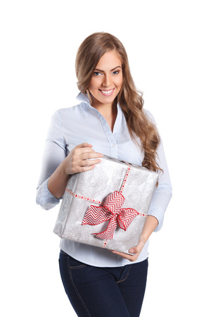 beautifully wrapped: Pretty woman holding a beautifully wrapped gift