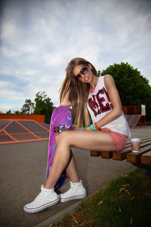 girl sport: Pretty woman with a skateboard