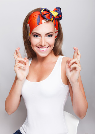 crossed fingers: Pretty woman with crossed fingers wishing good luck