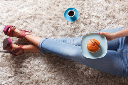 social drinking: Woman eating the delicious donut