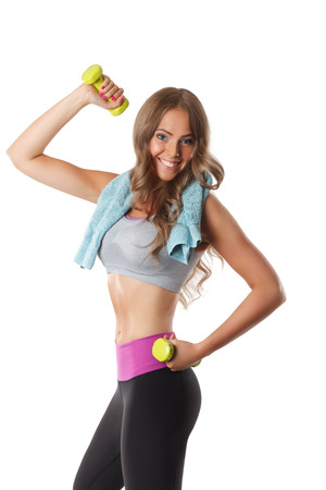fat burning: Beautiful fit woman doing arm exercises with dumbbells