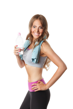 fat burning: Fit attractive woman holding the bottle of water During Workout