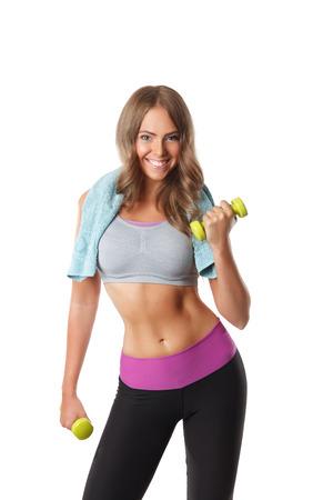 Fit gelukkige vrouw toning haar armen met halters Stockfoto