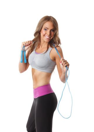 Lekker fit vrouw uit te werken met de jumprope Stockfoto