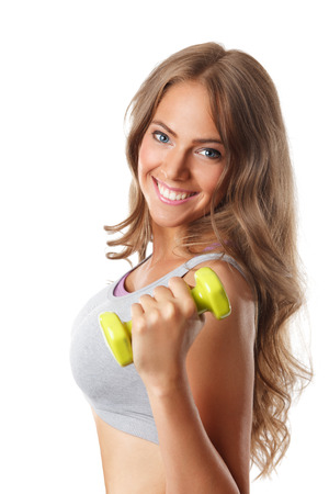 Close-up of a beautiful smiling woman with a dumbbell
