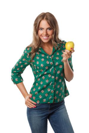 elegant girl: Beautiful happy woman on diet holding an apple