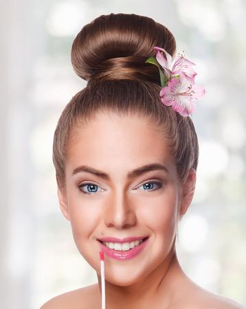 lipgloss: Beauty woman with lipgloss Stock Photo