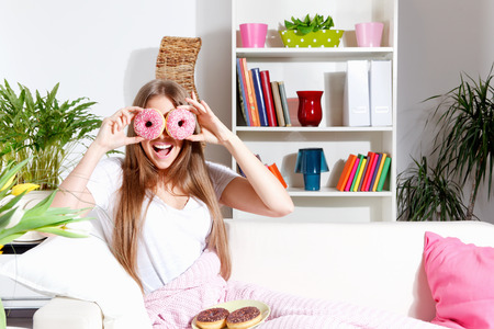 Funny Woman making fun with donuts