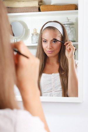 female beauty: Beauty woman brushing her eyebrow