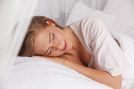 romance bed: Beautiful woman sleeping in the bed
