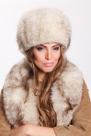 femme fatale: Attractive woman wearing fur rich Stock Photo