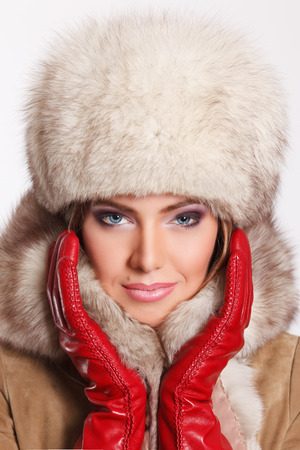 femme fatale: Closeup of a sexy woman in fur at winter