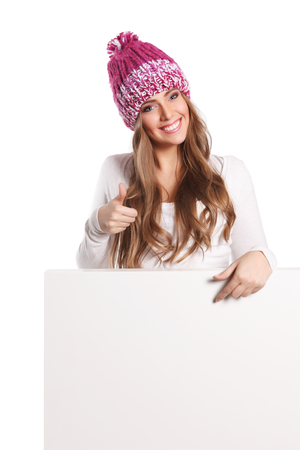 placard: Beautiful smiling woman pointing to a white board