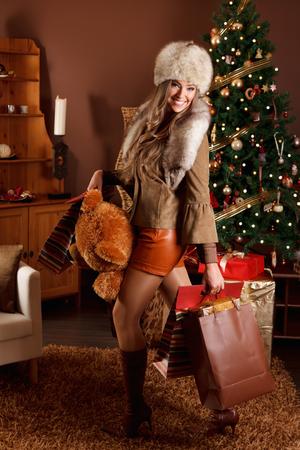 christmas woman: Pretty woman after Christmas shopping