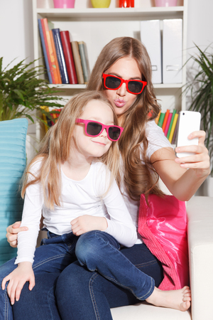 funny picture: Beautiful mother and child taking a selfie
