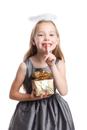 wrapped gift: Sweet child with a wrapped gift isolated Stock Photo