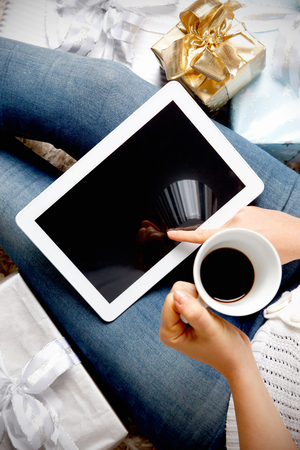 Woman with a tablet having a coffee break