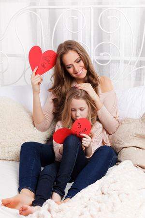 feel affection: Pretty mother and daughter having fun together Stock Photo