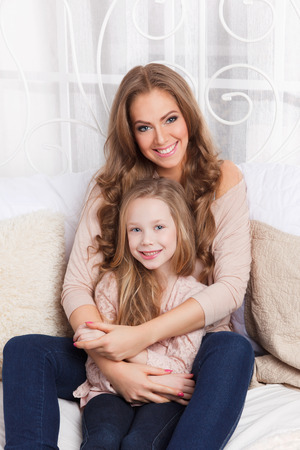 feel affection: Beautiful woman and little girl