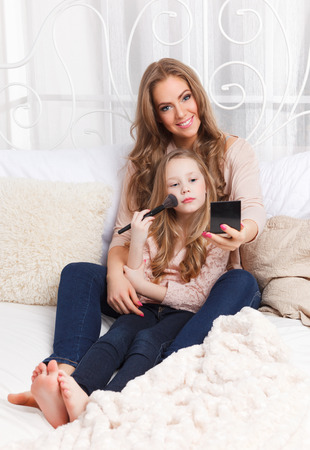 feel affection: Mother and daughter putting makeup