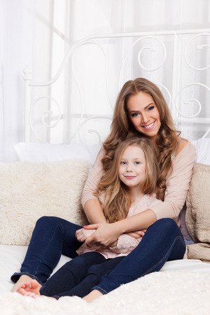 feel affection: Beautiful mother and daughter at home