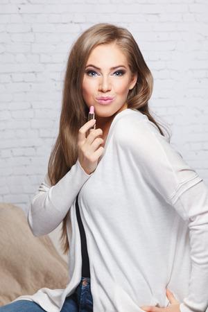 pouting: Beautiful woman pouting with a lipstick Stock Photo