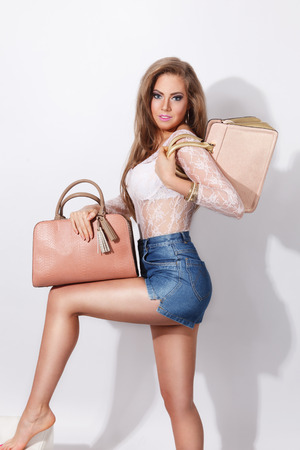 Sexy woman posing with fashionable bags