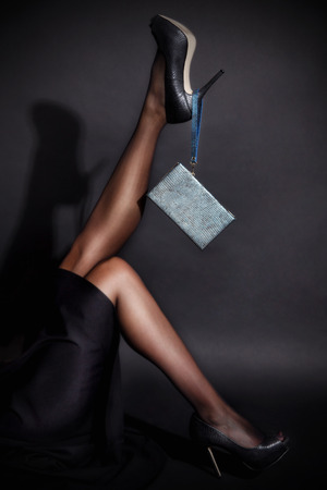heel: Close-up of a womans leg in nylon tights and high heels Stock Photo