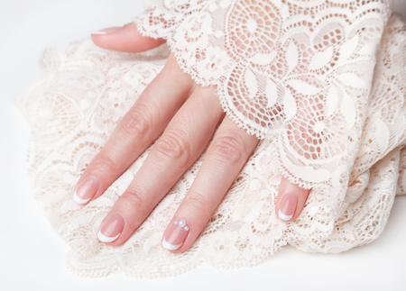 french manicure: Beautiful french manicure for wedding Stock Photo