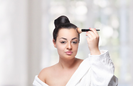 highlighting: Pretty woman highlighting her forehead