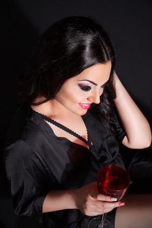 Sexy vrouw met een glas wijn Stockfoto