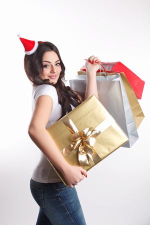 Beauty young woman carrying wrapped gifts Imagens
