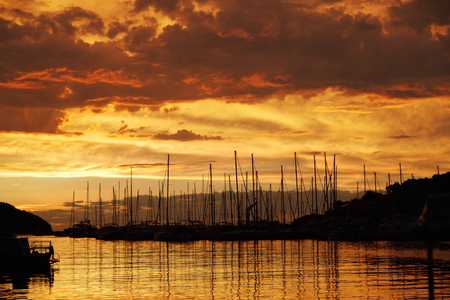 Silhouettes of sailboats in sunset Stock Photo