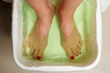 Woman feet in spa bowl