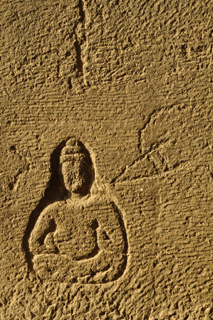 backlash: Buddha carved in brick Stock Photo