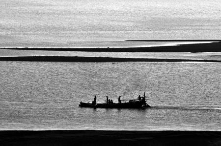 Silhouette of Boats fishing in the Indian River