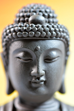 The face of Buddha Zen sculpture