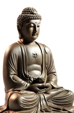 Zen Buddha sculpture on a white background Stock Photo