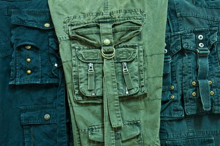black and green long pants have many bag photo