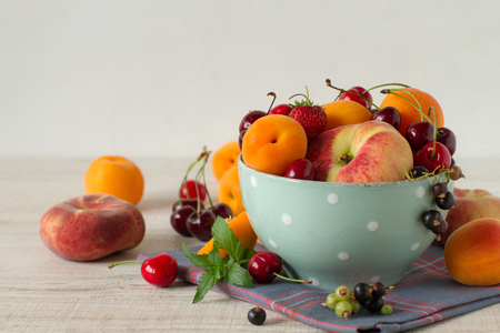 summer fruits: Vintage bowl with summer fruits Stock Photo