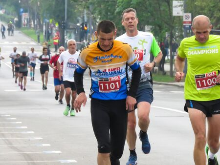 Belgrade, Serbia, April 14, 2019. The 32nd Belgrade Marathon. Runners from many countries running at city street. 新聞圖片