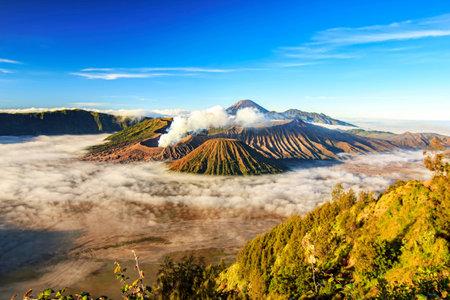 Bromo volcano national park with sunrise sky background and fog landscape Stock Photo