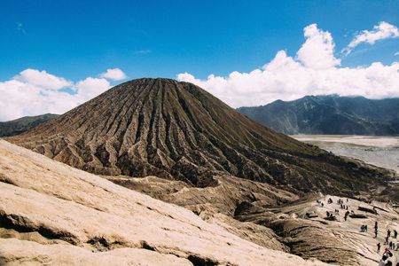 Bromo volcano mountain national park landscape with cloudy sky background