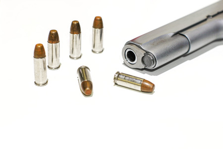 Automatic gun pistol with bullet in white background