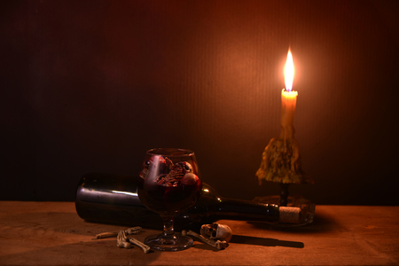 Skulls in the blood glass, on wooden plank in dim light halloween night / and space for texts