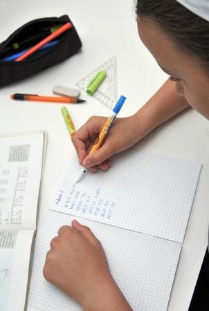 algebra: girl is making homework