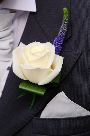 buttonhole: Grooms buttonhole flower at wedding Stock Photo