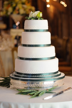 wedding cake: Green and white wedding cake at reception in barn.