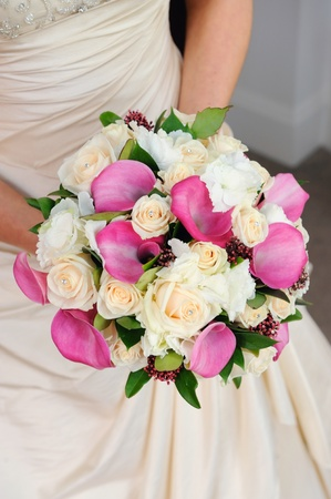 Bride holding her vibrant and colourful flowers.