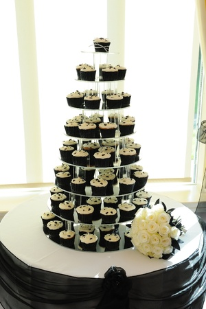 wedding cake: Cup cakes on display at a wedding reception.